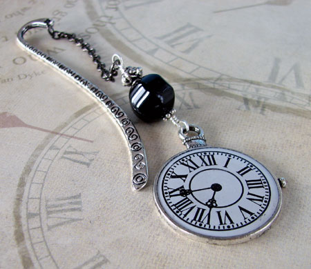 Pocket Watch Face Attached To An Antique Silver-Plated Bookmark Hook
