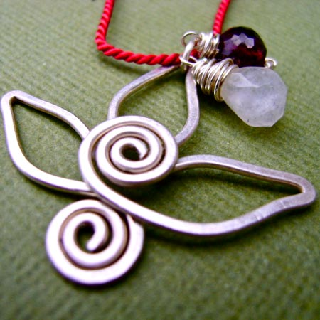 Spiral Lotus Pendant With Moonstone And Garnet Gemstones