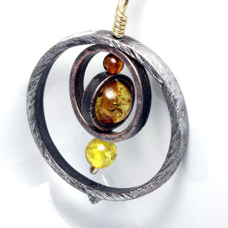 Three Ring Pendant with Amber Bead Focal
