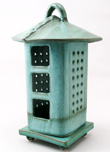 Porcelain and Stoneware Votive Lantern With A Rustic Bronze Glaze